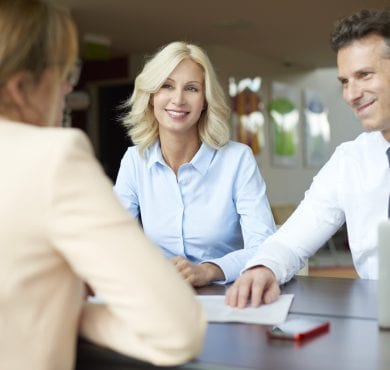 Senior agent and her clients planning business investment
